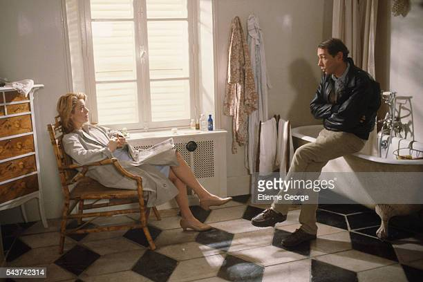 French actress Catherine Deneuve and French director André Téchiné on the set of the film 'Le Lieu du crime'