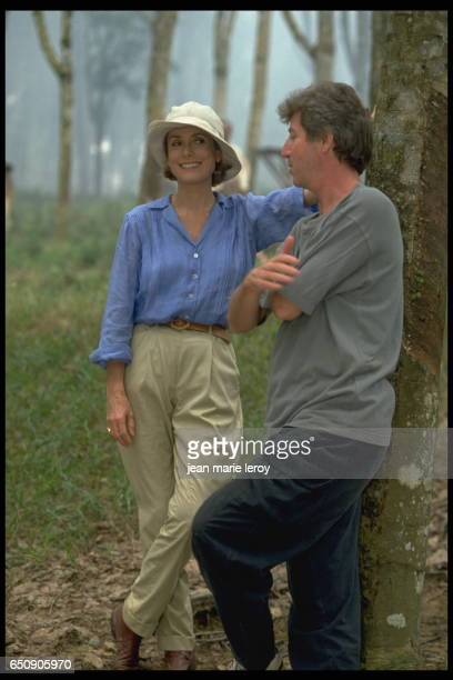 """French actress Catherine Deneuve and French director, screenwriter and actor Régis Wargnier on the set of his film """"Indochine""""."""