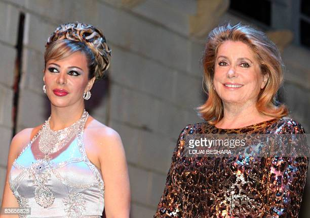French actress Catherine Deneuve and Syrian actress Suzan Najm attend the closing ceremony of the 16th Damascus International Film Festival in the...