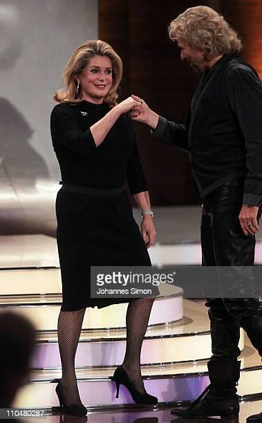 French actress Catherine Deneuve and TVhost Thomas Gottschalk attend the 'Wetten Dass ' TV show at Augsburg fair ground on March 19 2011 in Augsburg...