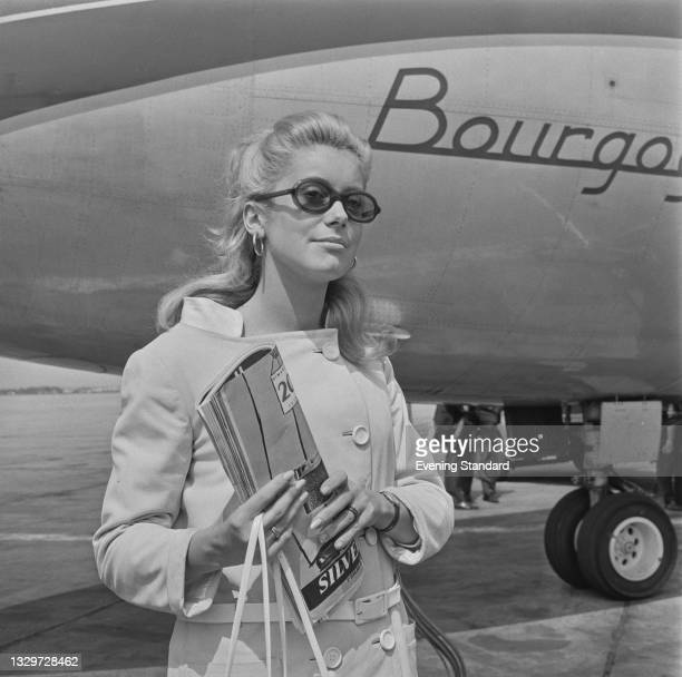 French actress Catherine Deneuve arrives at London Airport to attend the premiere of the Roman Polanski film 'Repulsion', in which she stars, UK,...