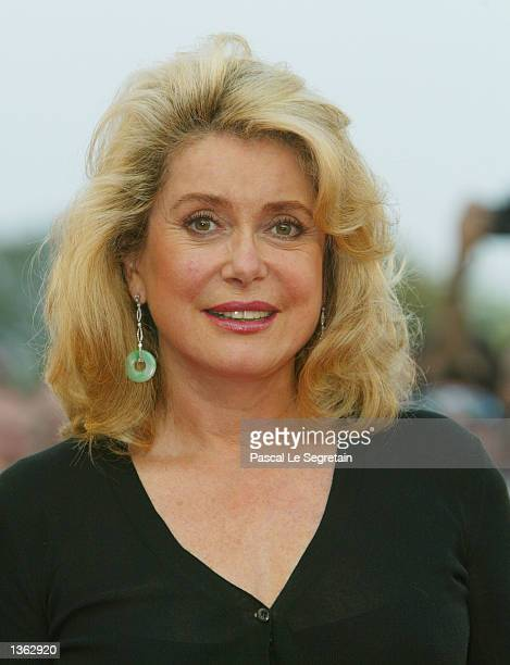 French actress Catherine Deneuve arrives for the screening of the Tonie Marshall's film Au plus pres du paradis at the 59th Venice Film Festival...