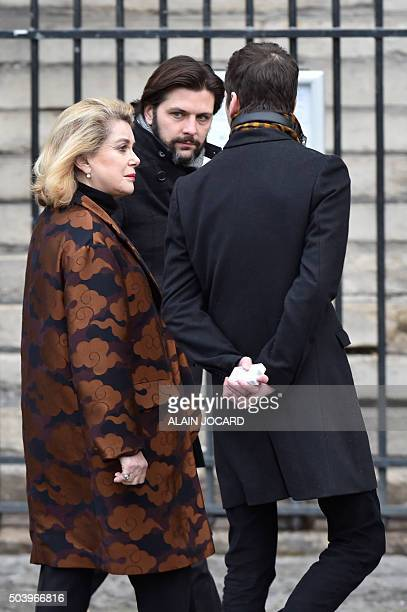 French actress Catherine Deneuve arrives to attend the funeral ceremony of late French singer Michel Delpech on January 8 2016 at SaintSulpice church...