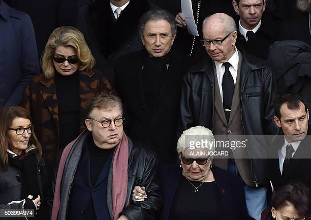 French actress Catherine Deneuve French film producer Dominique Besnehard french TV host Michel Drucker and french singer Line Renaud leave after...