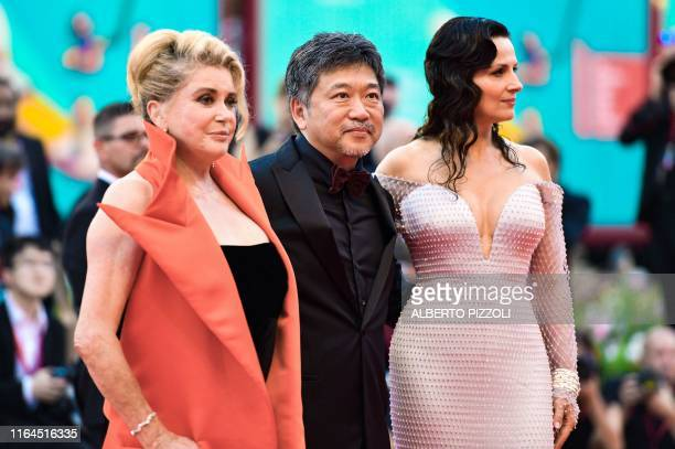 TOPSHOT French actress Catherine Deneuve Japanese director Hirokazu Koreeda and French actress Juliette Binoche arrive for the opening ceremony and...