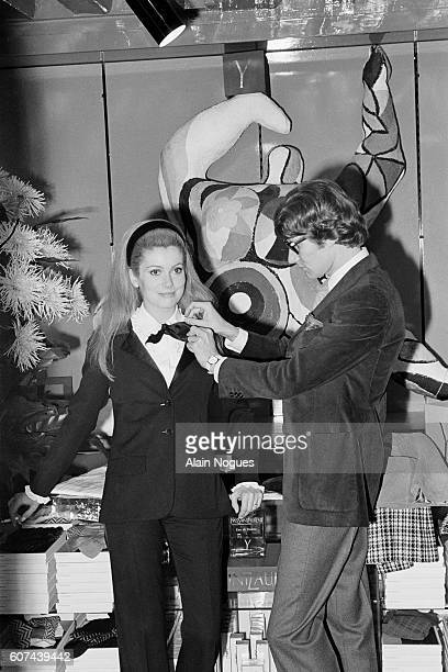 French actress Catherine Deneuve models an outfit for French fashion designer Yves Saint Laurent.