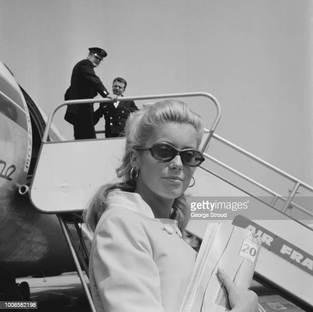 French actress Catherine Deneuve pictured at London Airport on 11th June 1965 Catherine Deneuve is in London for the premiere of the Roman Polanski...