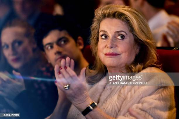 French actress Catherine Deneuve president of the Premiers Plans film festival applauds during the festival's opening session on January 15 in Angers...