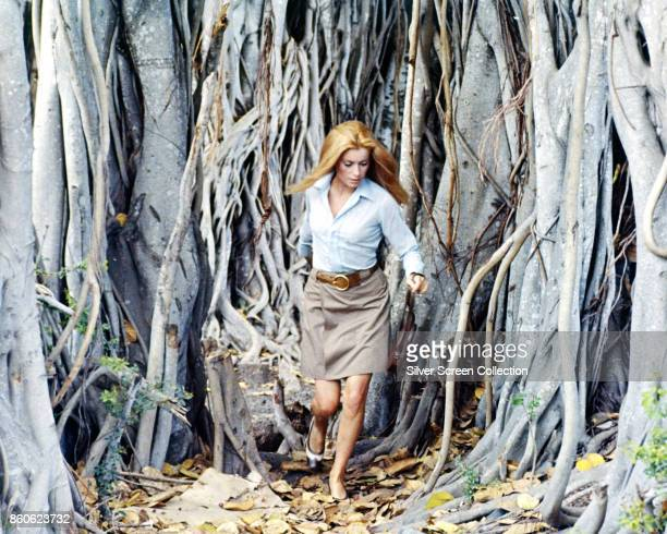 French actress Catherine Deneuve runs through trees in a scene from 'La sirene du Mississipi' also known as 'Mississippi Mermaid' France 1969