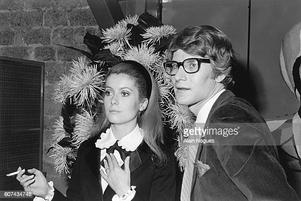 French actress Catherine Deneuve stands with fashion designer Yves Saint Laurent for whom she sometimes models