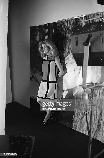 French actress Catherine Deneuve wears fashions by Yves Saint Laurent at a photoshoot by German photographer Helmut Newton 16th November 1981 Behind...