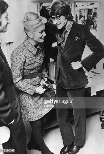 French actress Catherine Deneuve with French fashion designer Yves SaintLaurent backstage at one of Saint Laurent's fashion shows Paris 30th January...