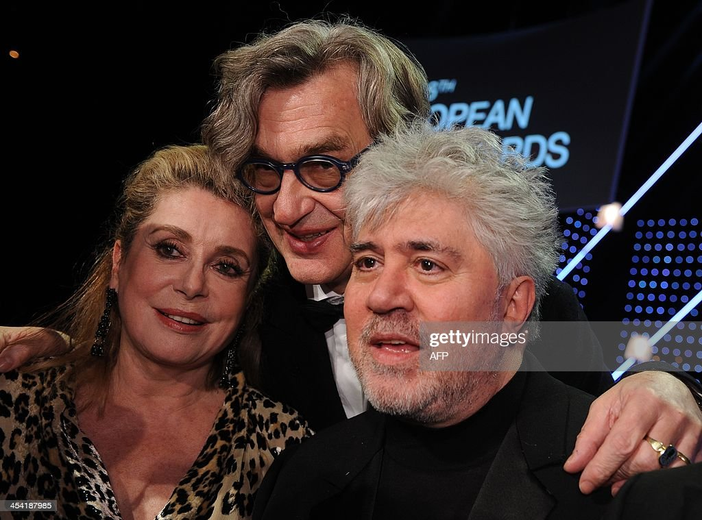 French actress Catherine Deneuve,German director Wim Wenders and Spanish director Pedro Almodovar pose at the 26th European Film Awards ceremony on December 7, 2013 in Berlin. Every year, the various activities of the European Film Academy culminate in the ceremony of the European Film Awards. In a total of 21 categories, among them European Film, European Director, European Actress and European Actor, the European Film Awards annually honour the greatest achievements in European cinema.