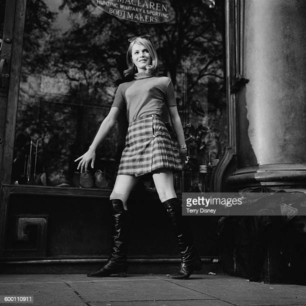 French actress Catherine Jourdan poses outside the Maclaren hunting and sporting bootmakers UK 26th November 1967