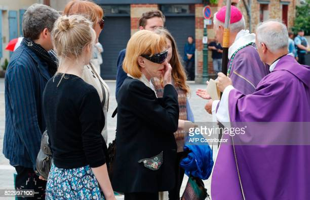 French actress Catherine Rich widow of late French actor Claude Rich reacts as she arrives for the funeral ceremony at the Saint Pierre Saint Paul...