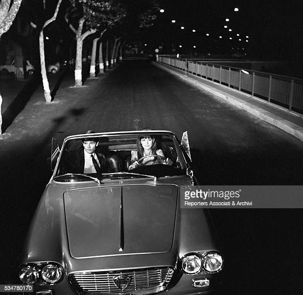 French actress Catherine Spaak and Italian actor Fabrizio Moroni driving in Made in Italy Italy 1965