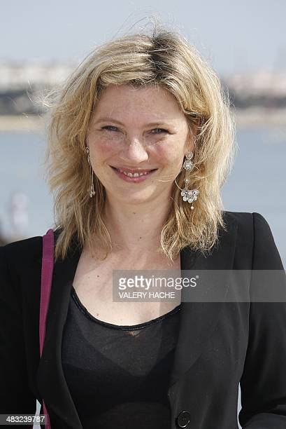 French actress Cecile Bois poses during a photocall for the serie Candice Renoir during the MIPTV on April 7 2014 in Cannes on the French Riviera AFP...