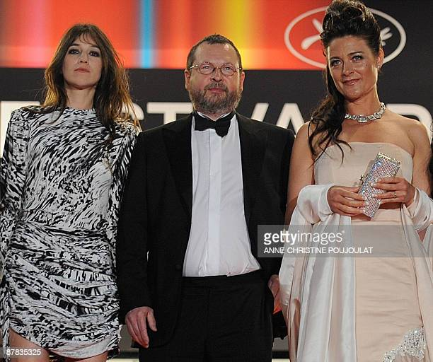 French actress Charlotte Gainsbourg Danish director Lars Von Trier his wife Bente Froge arrive for the screening of the movie Antichrist directed by...