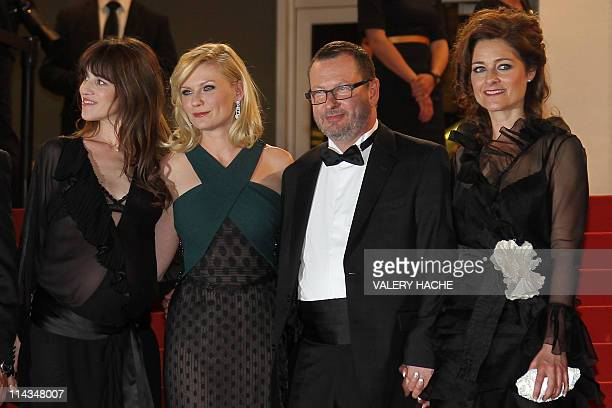 French actress Charlotte Gainsbourg US actress Kirsten Dunst Danish director Lars Von Trier and wife Bente Froge pose on the red carpet before the...