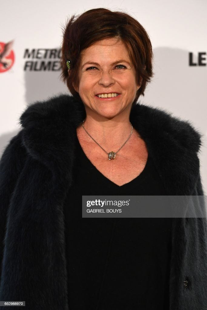 French actress Charlotte Valandrey poses during the photocall for the premiere of the film 'Chacun Sa Vie' in Paris on March 13, 2017. The film is directed by French director Claude Lelouch. /