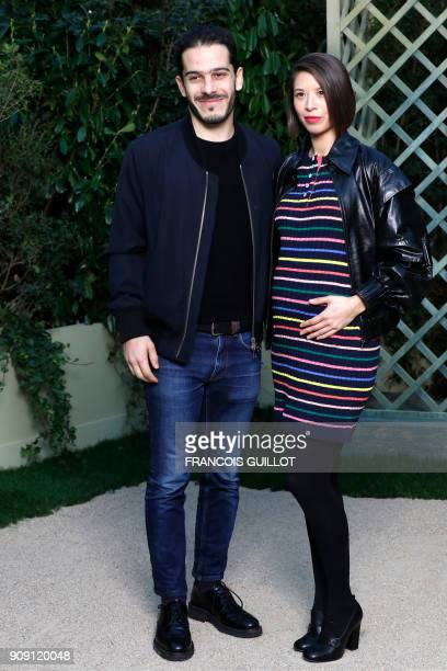 French actress Claire Tran and a guest pose for a photocall prior to the Chanel's fashion show during the 2018 spring/summer Haute Couture collection...