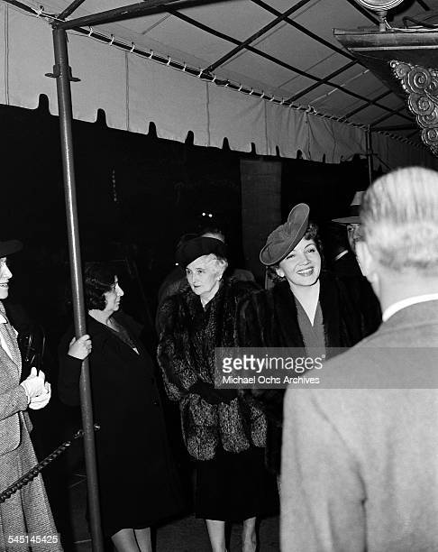 French actress Claudette Colbert and her mother Jeanne Loew Chauchoin attend an event in Los Angeles California