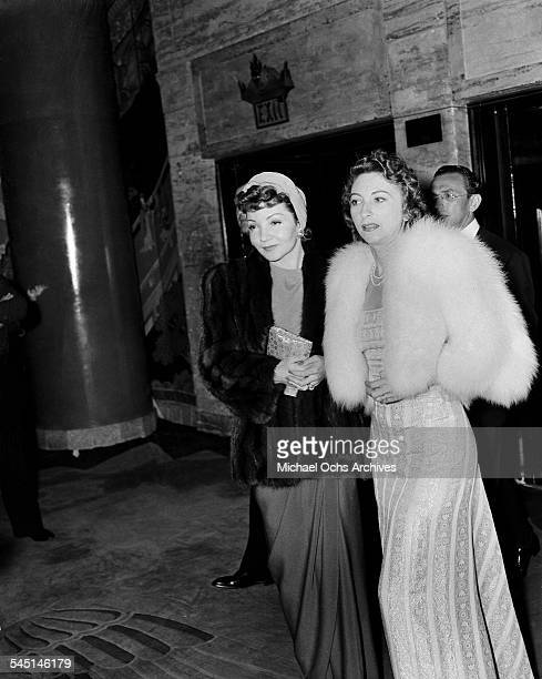 French actress Claudette Colbert attends an event with a friend in Los Angeles California