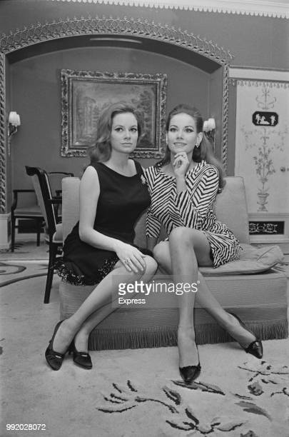 French actress Claudine Auger and Italian actress Luciana Paluzzi who star together in the James Bond film Thunderball pictured together in London on...