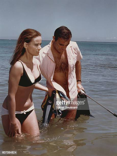 French actress Claudine Auger and Scottish actor Sean Connery star in director Terence Young's 1965 James Bond movie Thunderball known in French as...