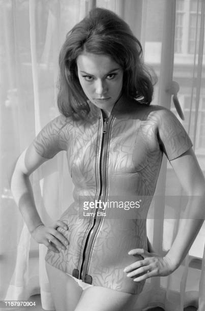 French actress Claudine Auger wearing a 'frogman' style costume with sleeves and zippers UK 26th February 1965