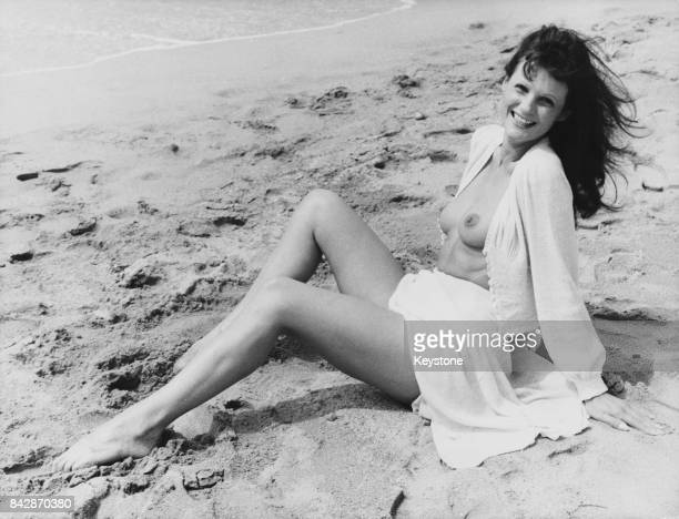 French actress Claudine Beccarie poses on the beach during the Cannes Film Festival where she is promoting her latest film the erotic drama...