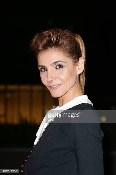 French actress Clotilde Courau poses as she arrives to attend the inauguration ceremony of the Cite du cinema a film studios complex heralded as...