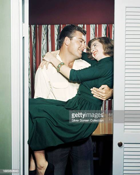 French actress Corinne Calvet in the arms of her first husband American actor John Bromfield circa 1950