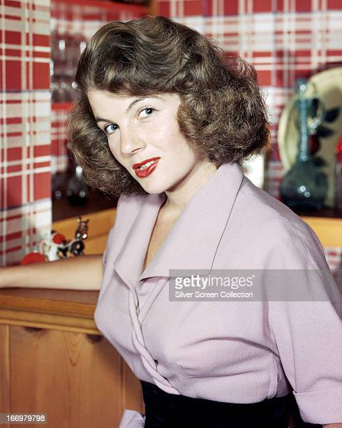 French actress Corinne Calvet wearing a mauve blouse circa 1950