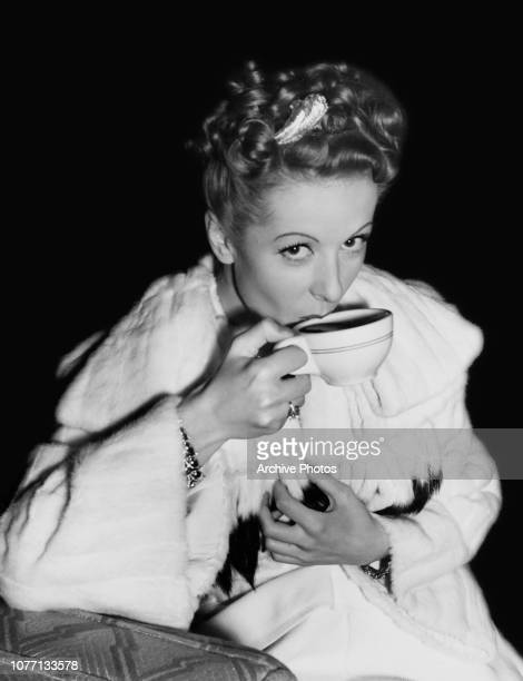 French actress Danielle Darrieux takes coffee on the set of the Universal Pictures film 'The Rage of Paris' USA circa 1938