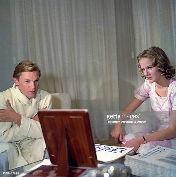 French actress Dominique Sanda and Austrian actor Helmut Berger looking at a frame in a scene from the film The Garden of the FinziContinis Italy 1970