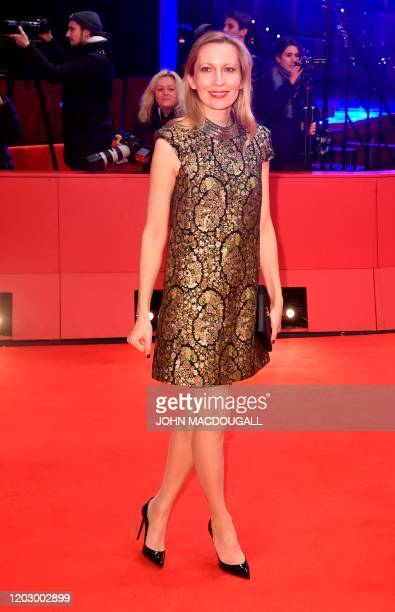 """French actress Dounia Sichov poses on the red carpet upon arrival for the premiere of the film """"Siberia"""" screened in competition on February 24, 2020..."""