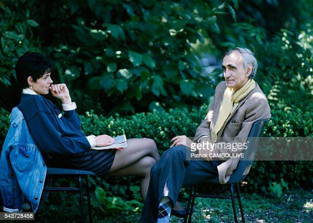 """French actress Elisabeth Bourgine and director Pierre Granier-Deferre on the movie set of """"Cours Privé""""."""