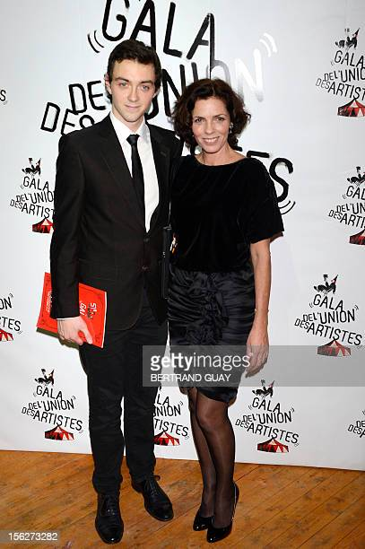 French actress Elizabeth Bourgine and her son Jules pose on arrival to the 50th edition of the Gala de l'union des Artistes held at the Alexis Gruss...