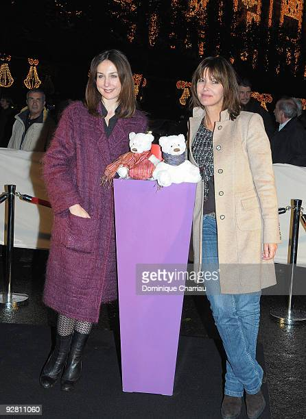 French actress Elsa Zylberstein and journalist Tina Kieffer attend the launch of the Christmas windows animations and lights at Galeries Lafayette on...