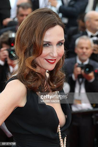 French actress Elsa Zylberstein poses on May 14 2016 as she arrives for the screening of the film The BFG at the 69th Cannes Film Festival in Cannes...