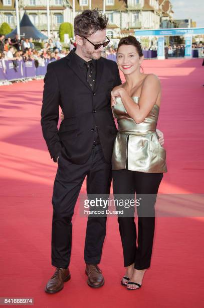 French actress Emma de Caunes and her husband British cartoonist Jamie Hewlett arrive at the opening ceremony of the 43rd Deauville American Film...