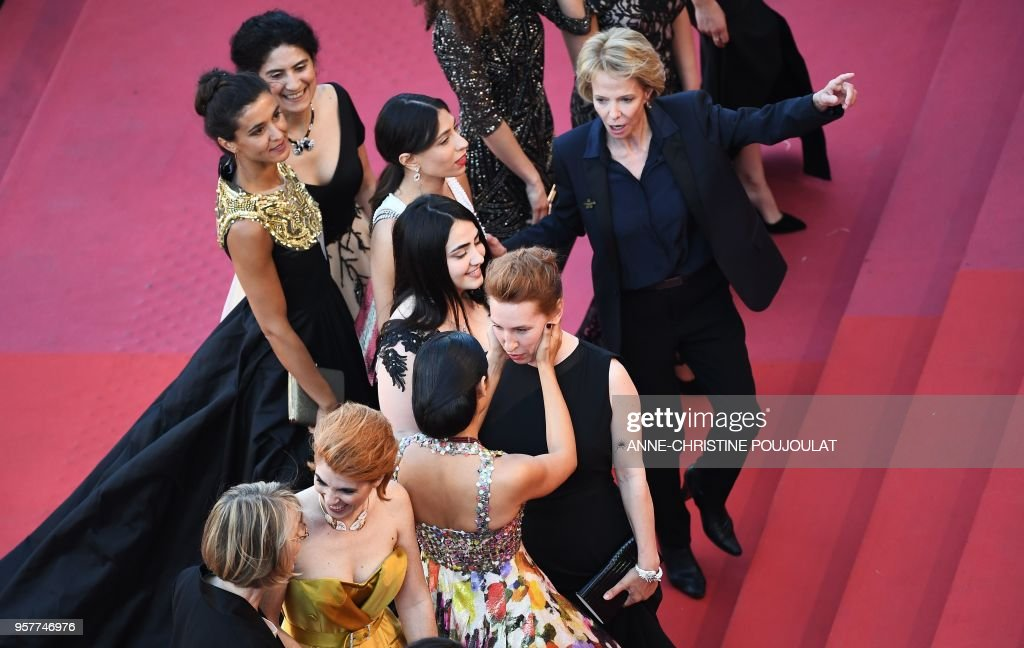 French actress Emmanuelle Bercot (C) and Iranian actress Golshifteh Farahani speak as they arrive on May 12, 2018 for the screening of the film 'Girls of the Sun (Les Filles du Soleil)' at the 71st edition of the Cannes Film Festival in Cannes, southern France.