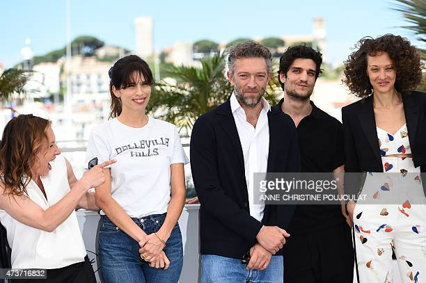 French actress Emmanuelle Bercot laughs during a photocall with French actress and director Maiwenn , French actor Vincent Cassel , French actor...