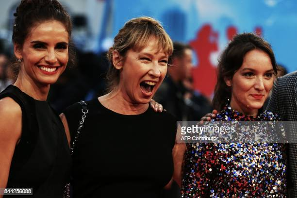 French actress Emmanuelle Bercot laughs flancked by FrenchChilean actress Leonor Varela and French actress Anais Demoustier as they pose on the red...
