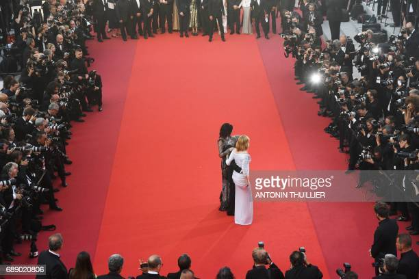 French actress Emmanuelle Seigner FrenchPolish director Roman Polanski and French actress Eva Green pose as they arrive on May 27 2017 for the...