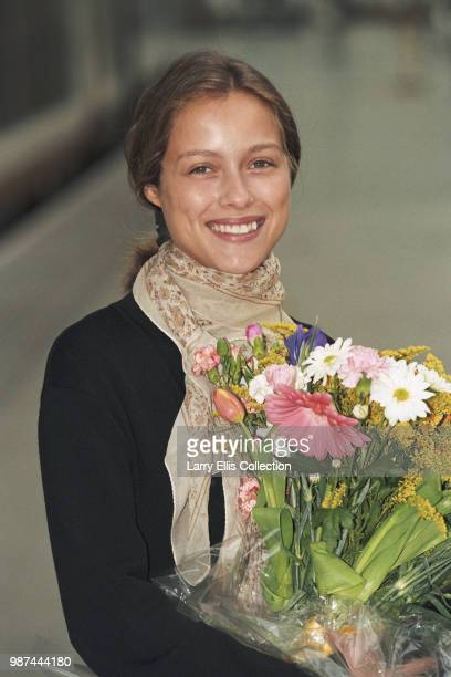 French actress Estelle Skornik pictured holding a bouquet of flowers at Waterloo station in London on 26th March 1997