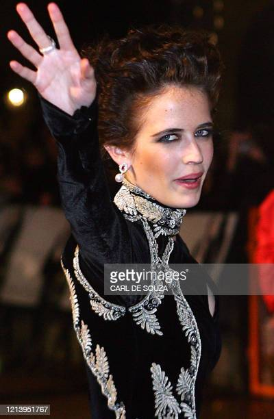 French actress Eva Green waves as she arrives at the world premiere of 'Casino Royale', the latest James Bond 007 action film, in London's Leicester...