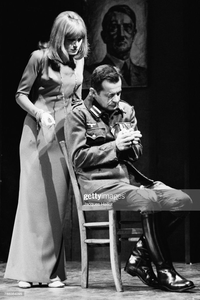 French actress Evelyne Rey performs with actor and singer Serge Reggiani in the play Les Sequestres d'Altona, written by Jean-Paul Sartre, at Theatre de la Renaissance in Paris.