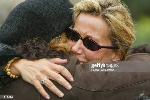 French actress Fiona Gelin is greeted by an unidentified friend at the funeral service for her father French actor Daniel Gelin December 4 2002 in...